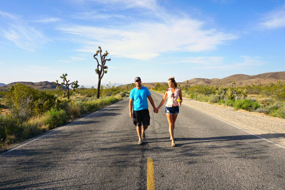 couple walking down street in Joshua Tree National Park California
