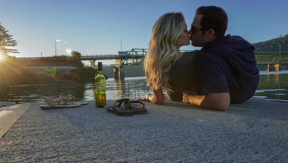 couple drinking wine by the columbia river gorge in hood river oregon
