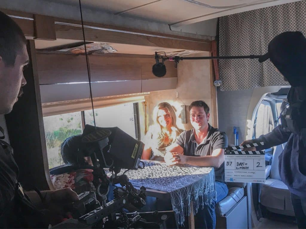 Couple being filmed in RV with camera crew