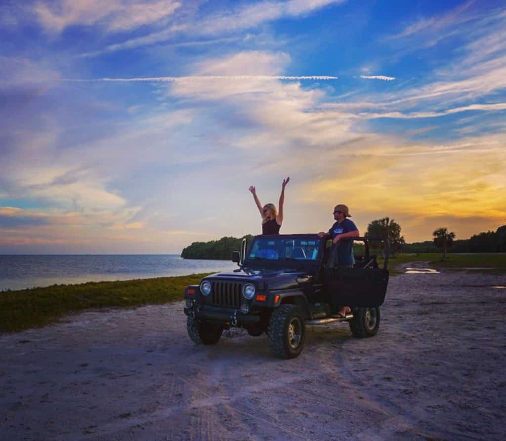 Jeep on the beach at sunset in Florida