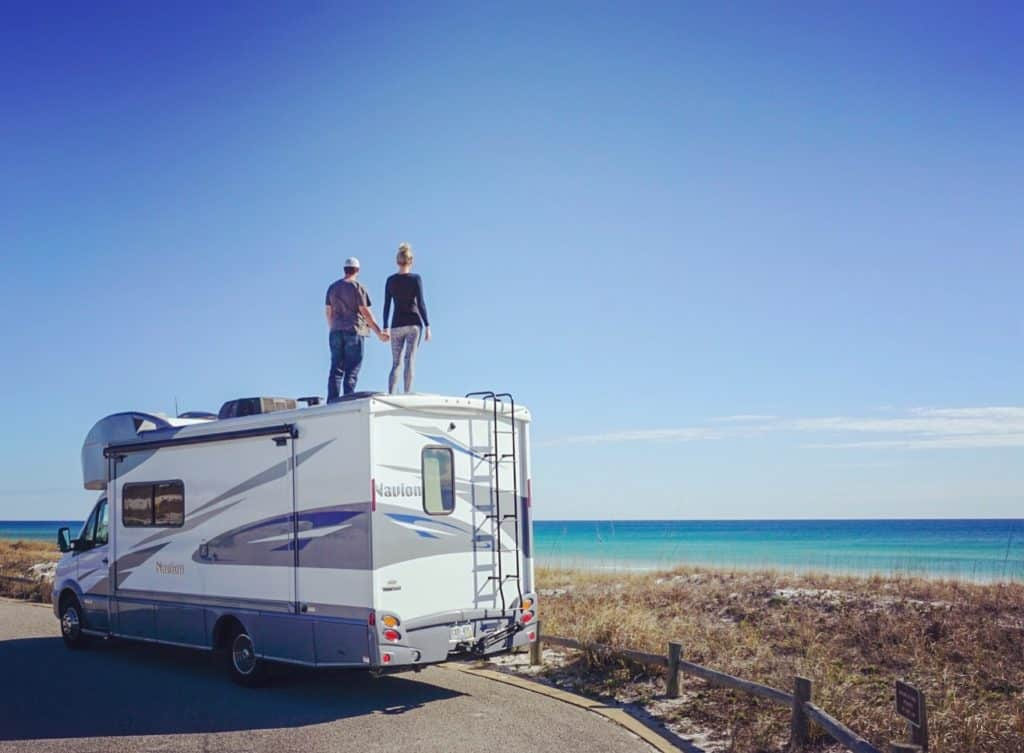 Couple on Roof of RV overlooking the ocean