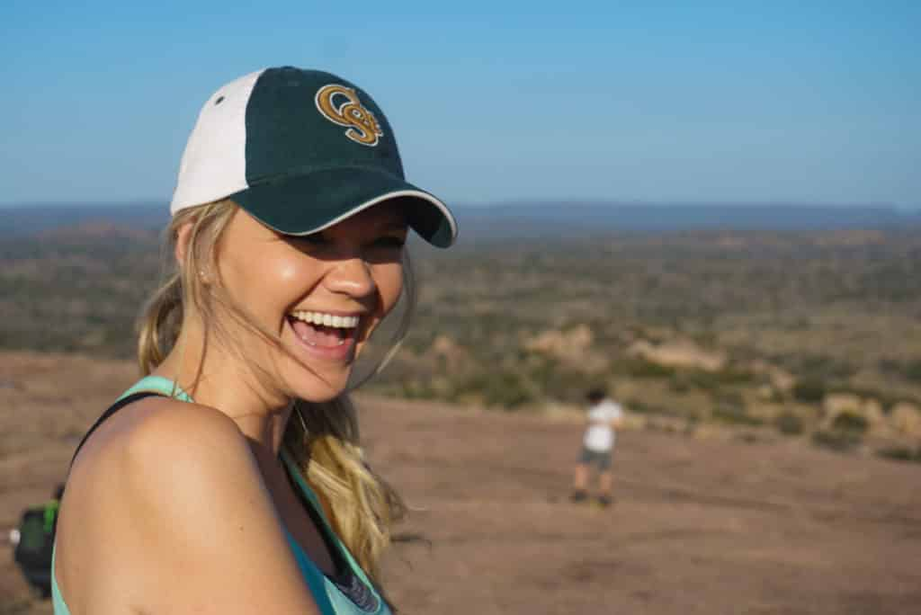 woman laughing on a hike in nature