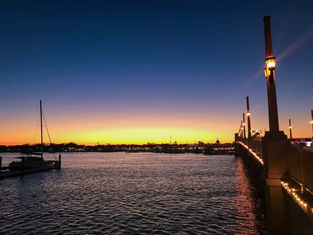 St. Augustine Bridge of Lions at sunset with sail boat