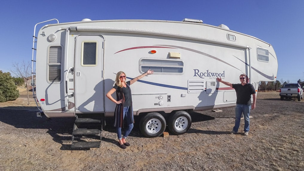 Young Couple standing in front of RV