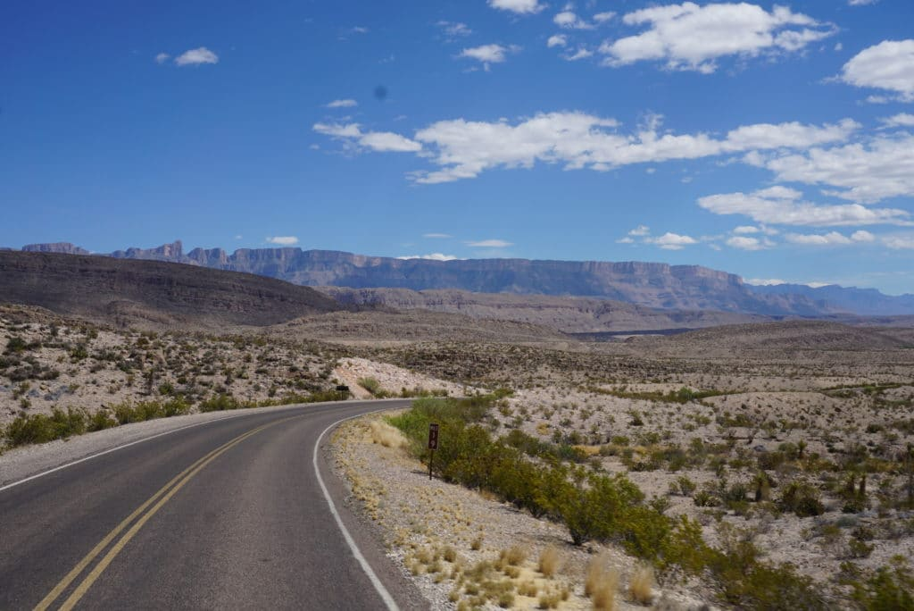 road in big bend national park with mountain and desert views
