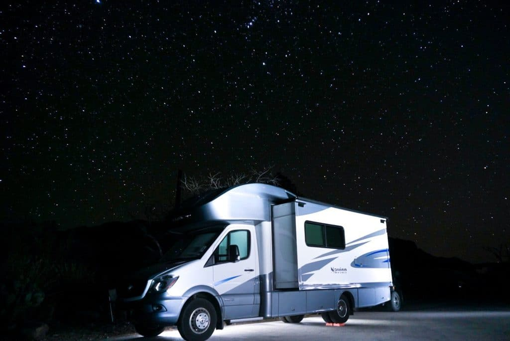 RV under the night sky with stars in Chisos basin campground Big Bend National park