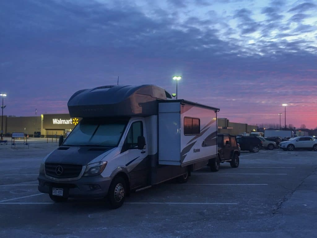 RV parked at a walmart with beautiful sunrise