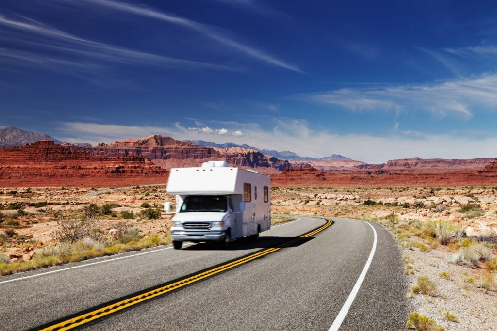 RV motorhome driving on scenic road in Utah