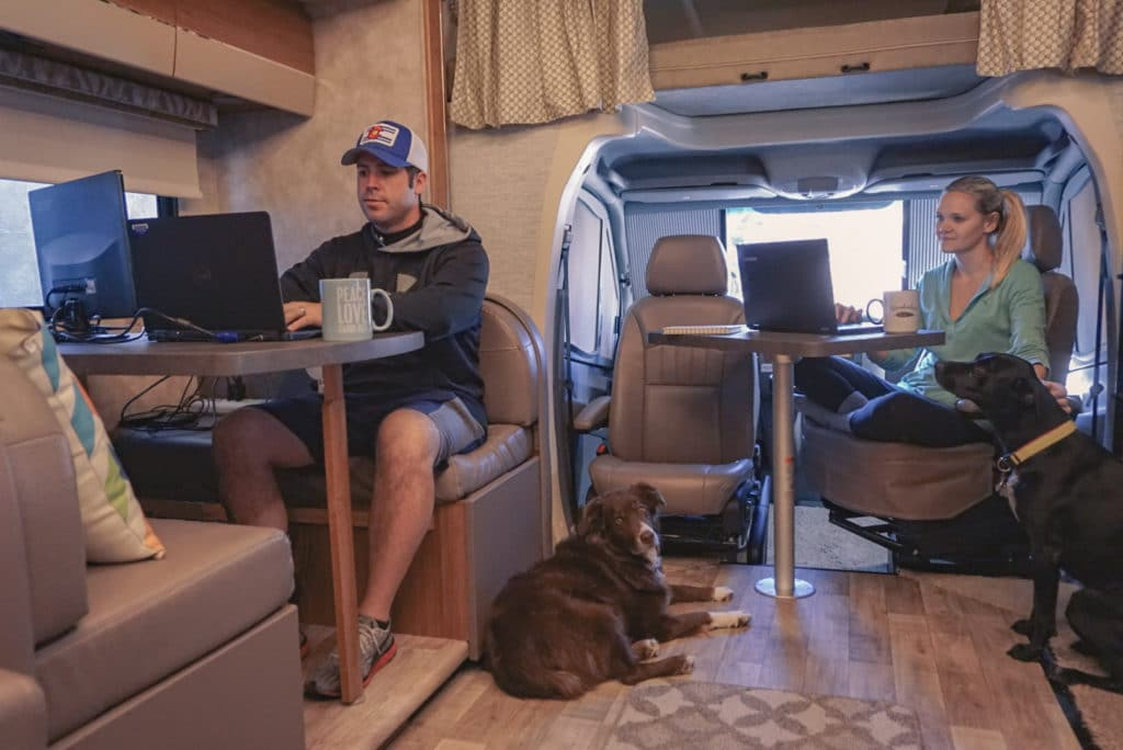 couple working on computers in an RV motorhome