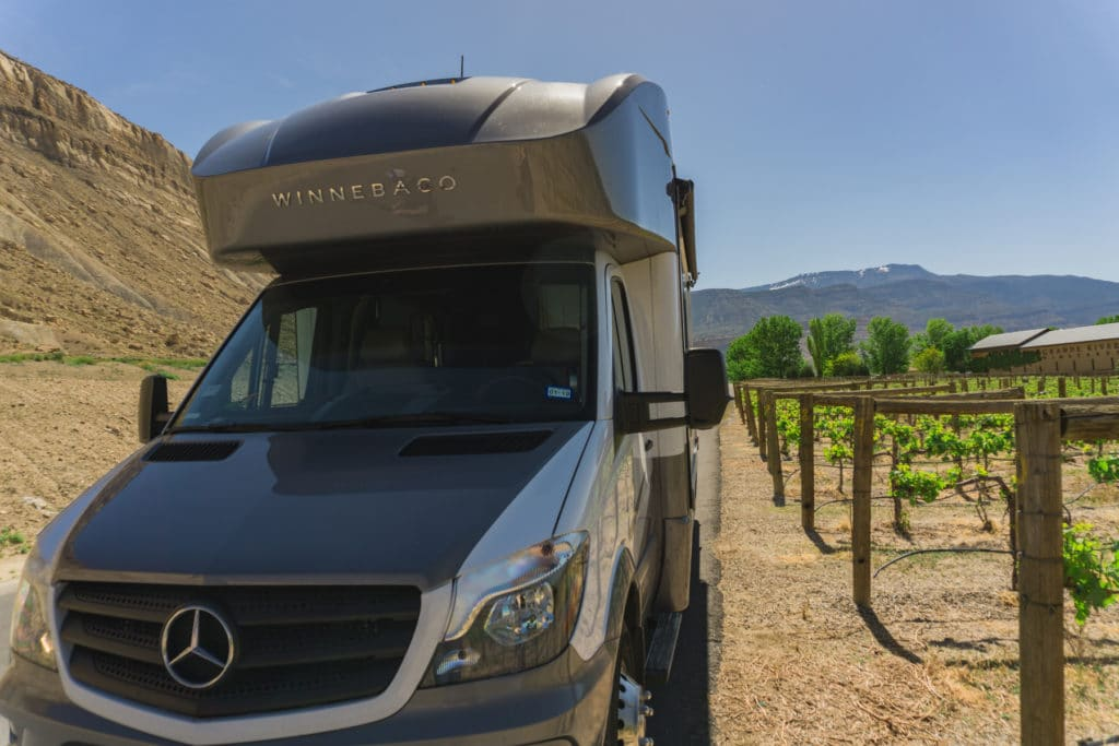RV parked next to vineyard