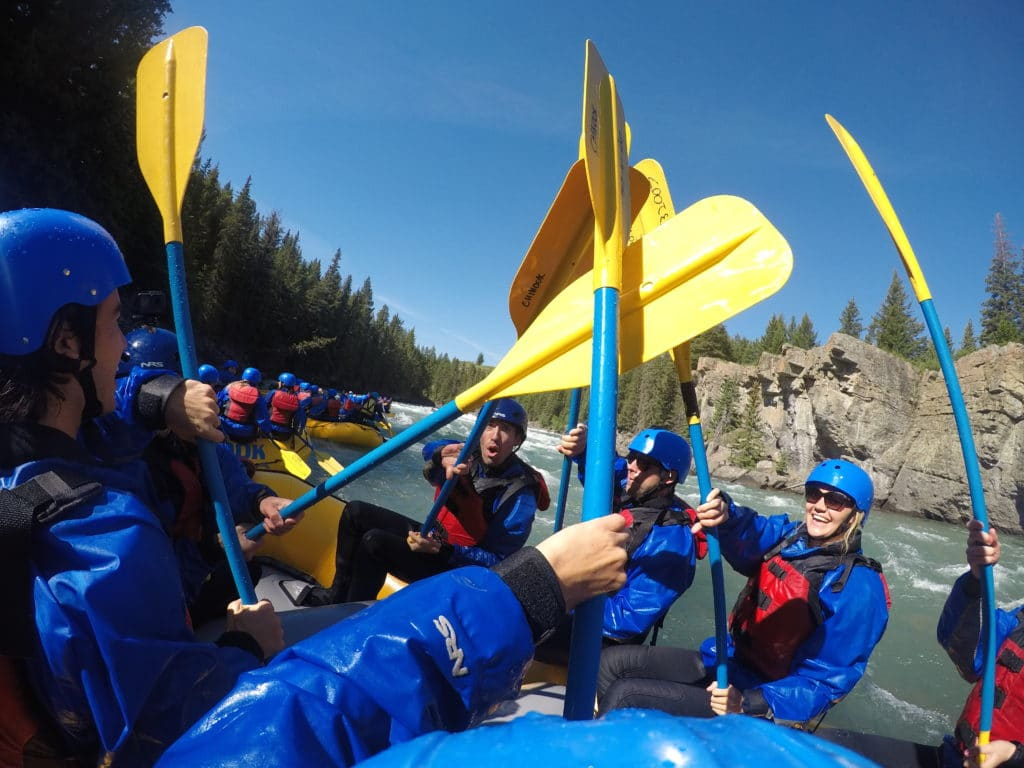 Group of friends white water rafting in Banff National park