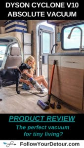 Dyson Cyclone v10 absolute vacuum in an RV camper with a woman and dog