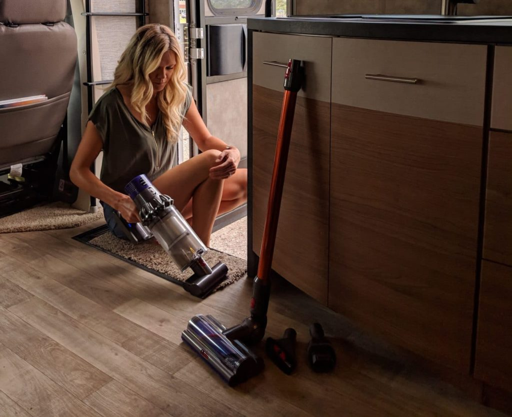 woman cleaning RV with Dyson Cyclone v10 vacuum