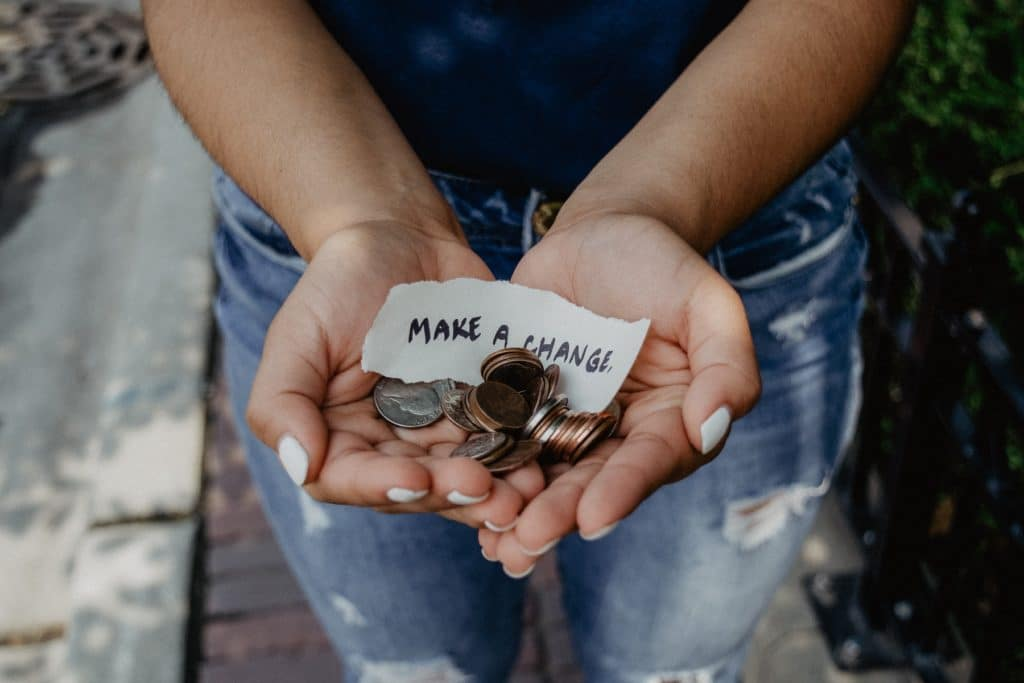 woman holding spare change in hands