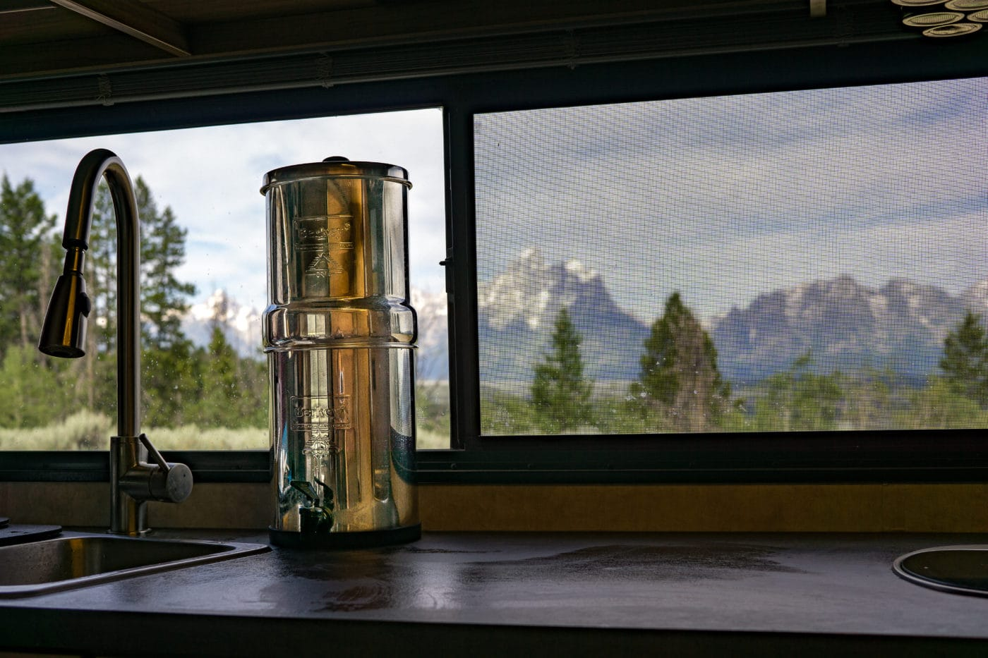 water filter system sitting on counter in rv camper kitchen