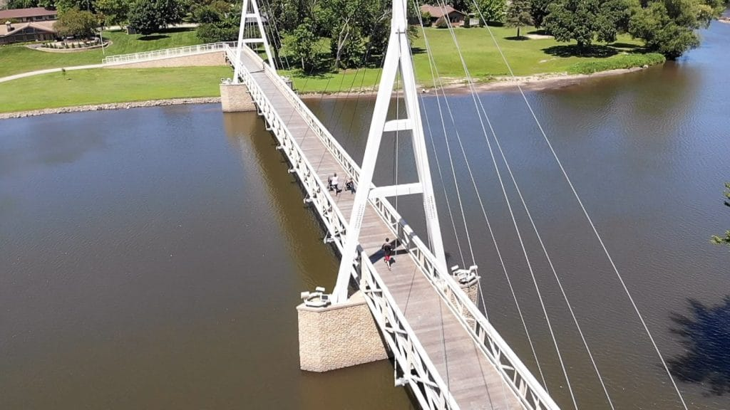 drone shot of the charles city suspension bridge