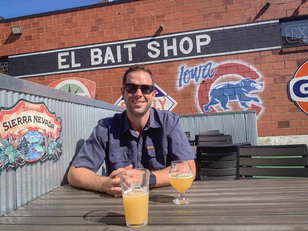 Man drinking a beer at el bait shop in des moines iowa