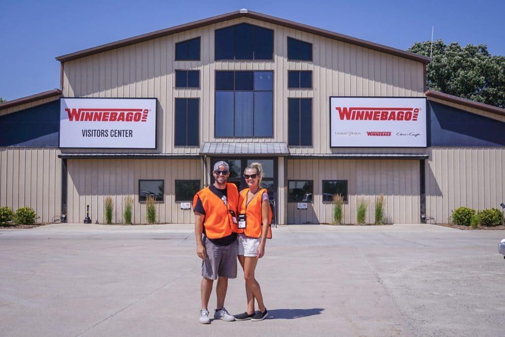 Couple standing in front of Winnebago Factory