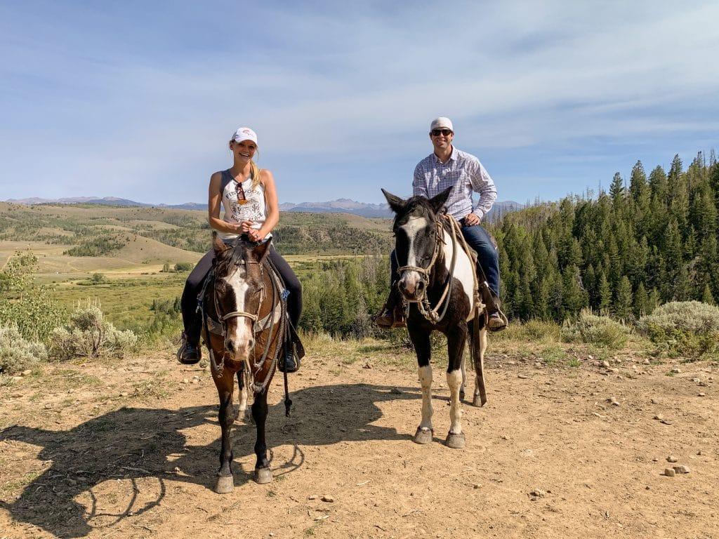 Couple Horseback riding in Granby, Colorado