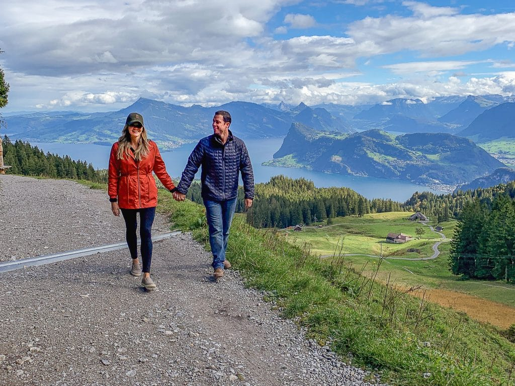 Couple walking along mountain in lucerne switzerland