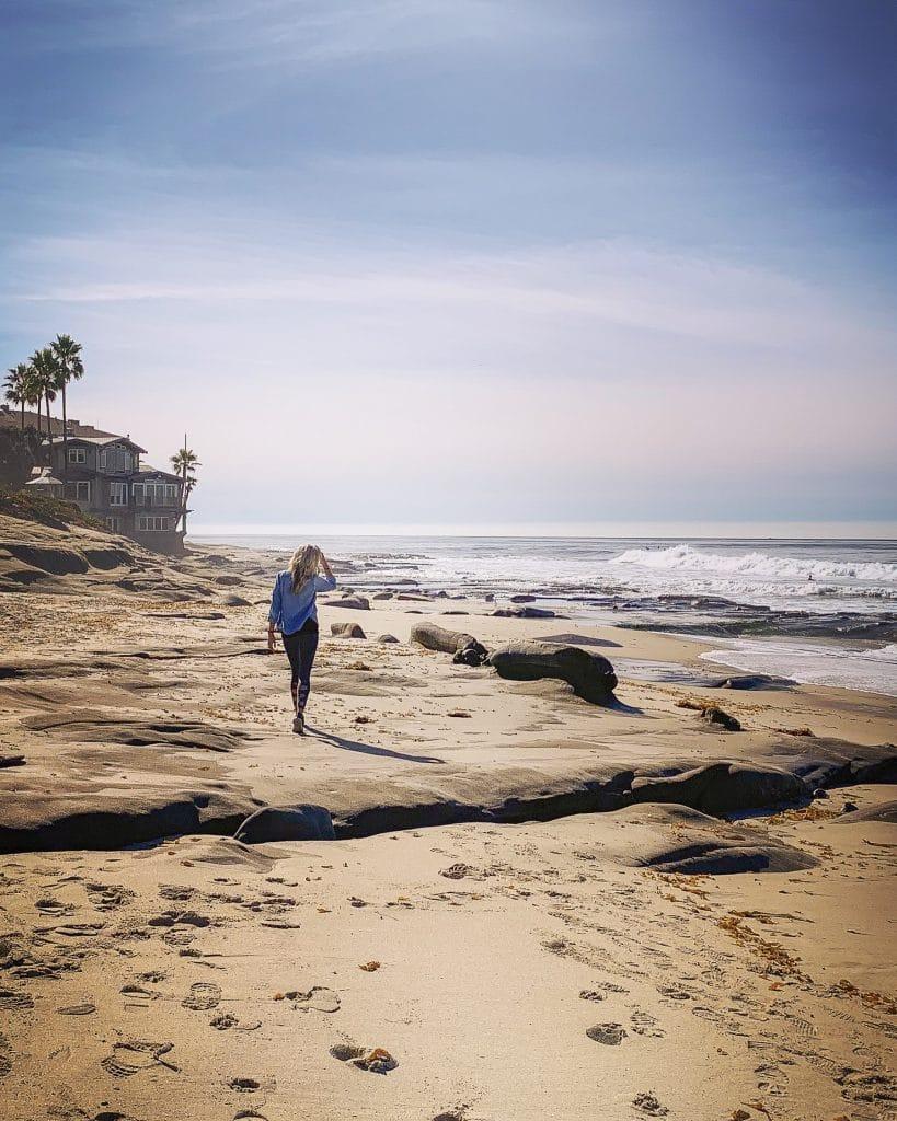 woman walking on beach in san diego california