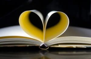 book with pages making heart