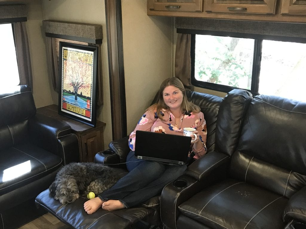 Woman working remote from RV fifth wheel