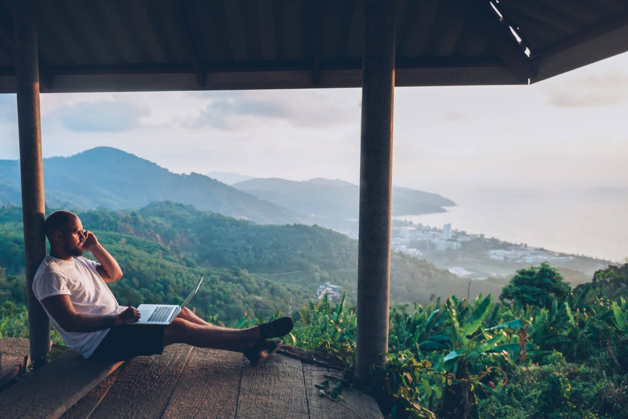 Man working remotely overlooking beautiful scenery