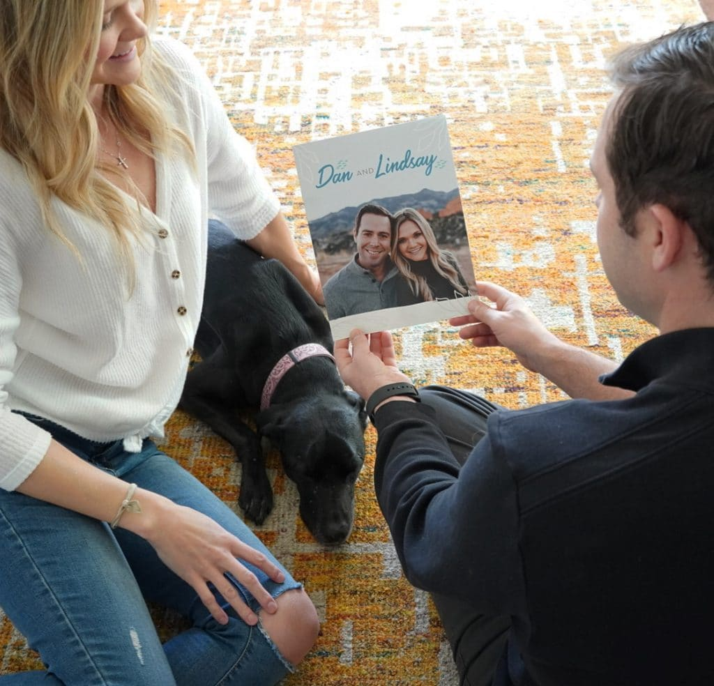 Couple looking at adoption profile book