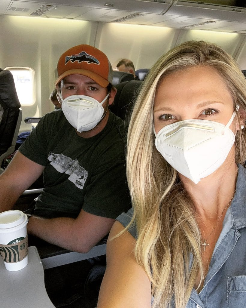 Couple on a plane wearing face masks during Covid-19