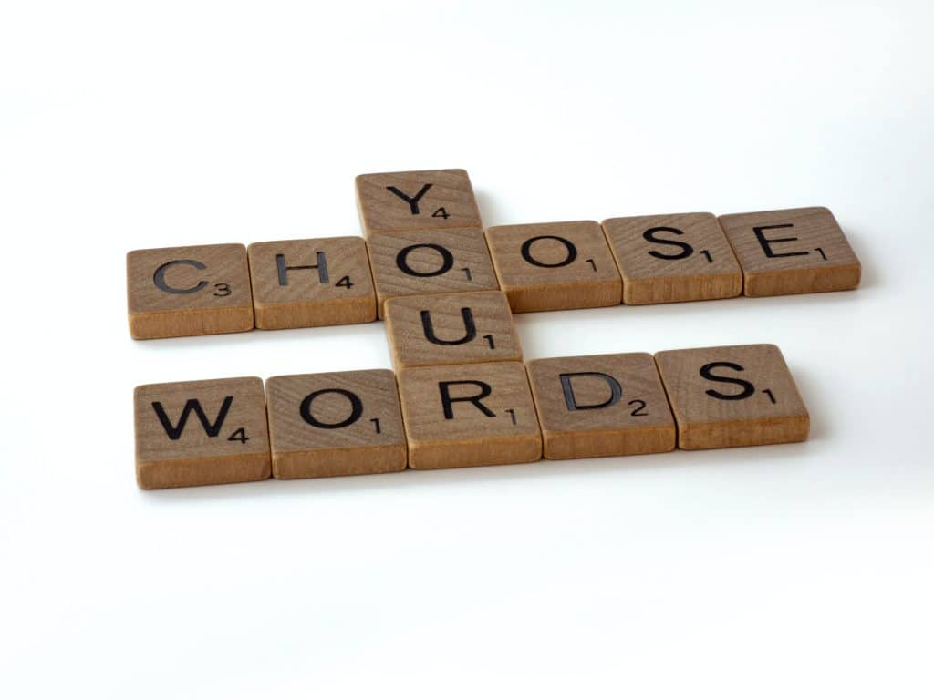 Scrabble tiles formed to say choose your words