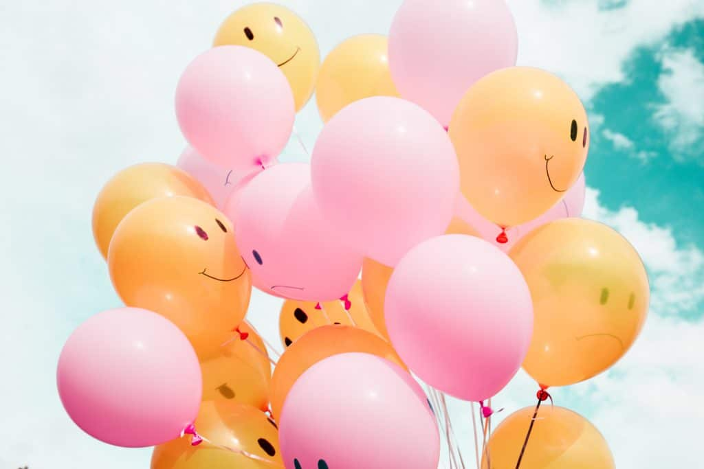 Balloons with smile faces on them