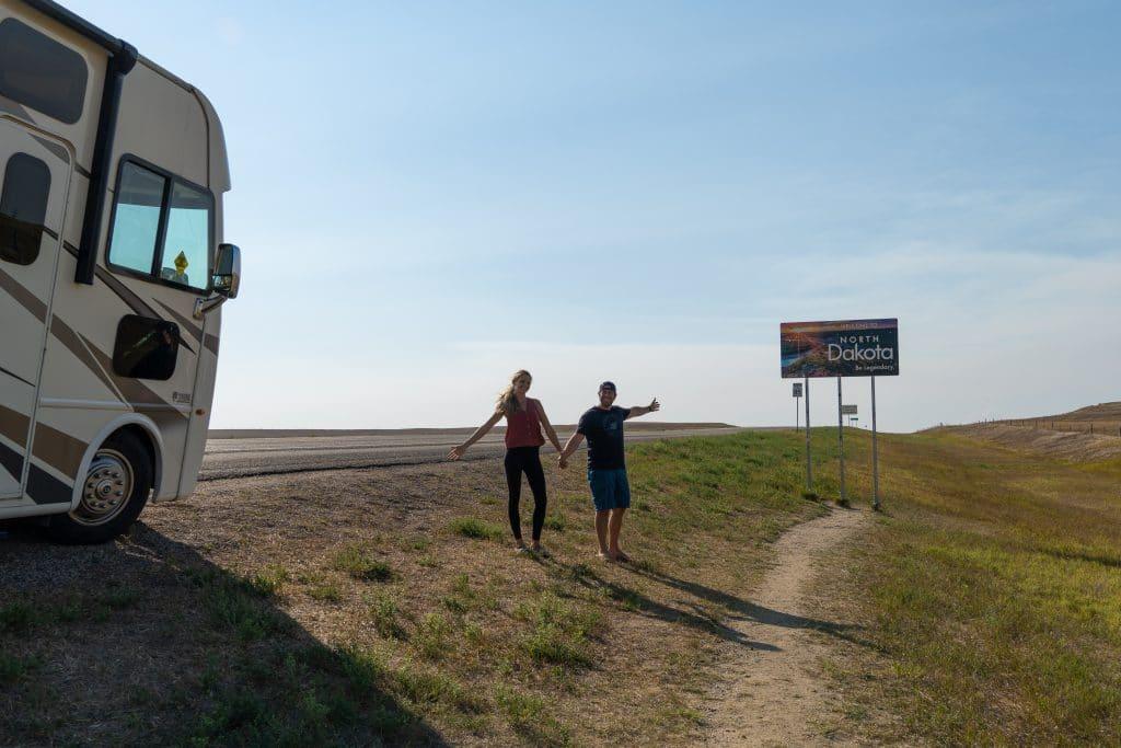 dan and lindsay in front of north dakota state sign